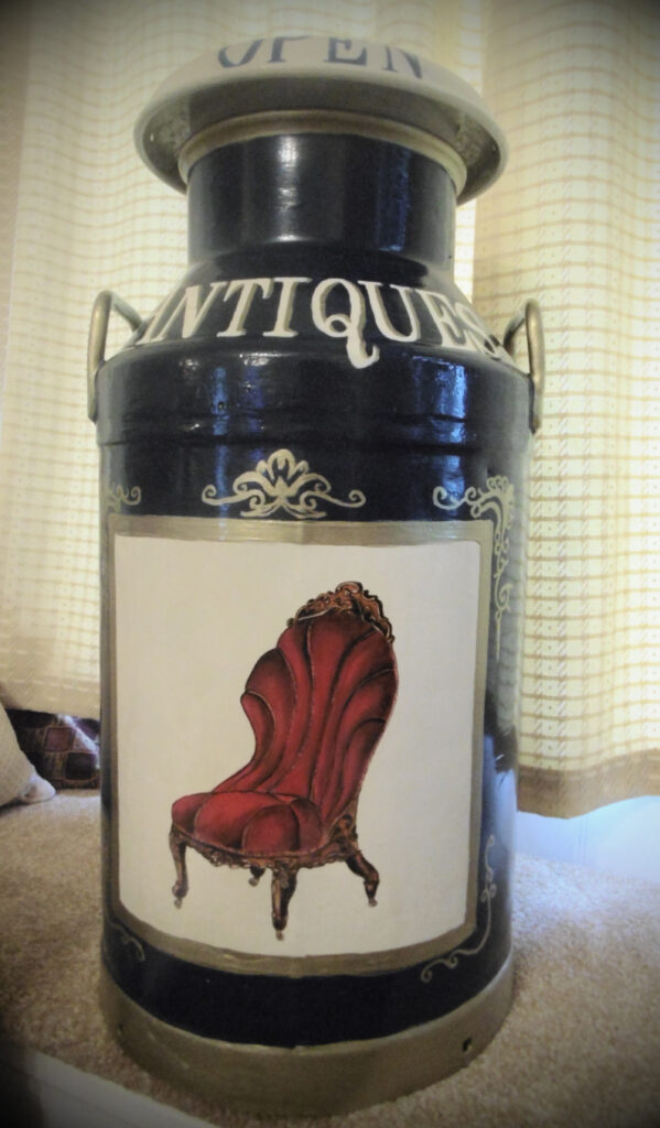 Milk Churn with painting of an armchair