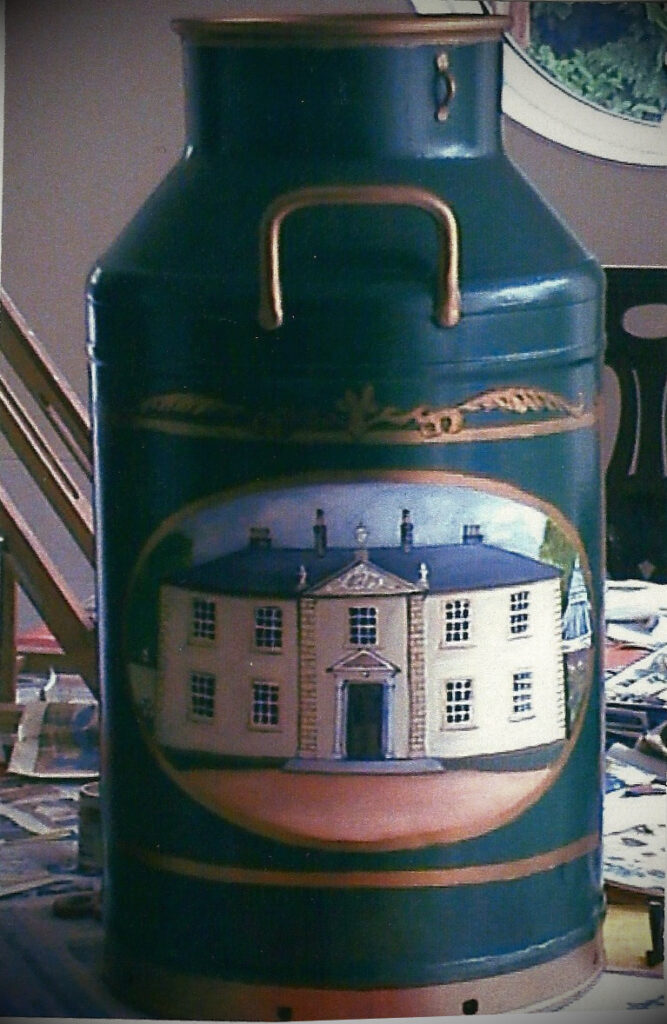Milk Churn with painting of Country Lodge